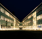 Exterior view of Taj Pharmaceuticals Diagnostics Graz, Austria, at night